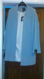 Light blue New coat, with original price tag