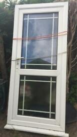 Double glazed door in frame