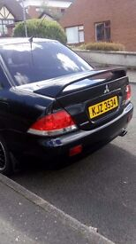 Mitsubishi Lancer .. Black with tinted windows, new tyres and exhaust