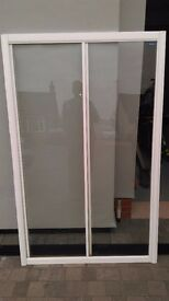 Used White 'Simpson' 1200mm single sliding shower door and fixed panel, for a recessed shower