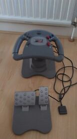 Steering wheel and pedals PS1