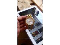 Gold sekonda watch