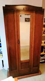 Wooden wardrobe with built in mirror.