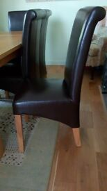 Dining room chairs. 8 Brown leather look. Will sell seperatly