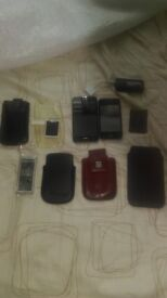 LG MetroPCS US Version & Unbranded Phone along with random cases, batteries and Duracell Charger