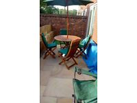 Wooden patio table and chairs with umbrella and all with a waterproof cover r