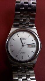 Gents Seiko SQ100 watch