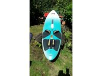 Mistral Evolution 310 windsurfing board plus sails and wet suits.