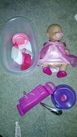 Baby born doll,bath and a pram