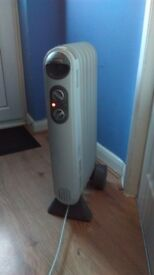 Holmes electric portable radiator heater with theromastat very safe to use.
