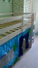 White, midsleeper bed frame, standard single mattress size with blue vehicles under bed tent
