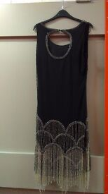 Beautiful beaded dress, size 16 from Roman. New with tags.