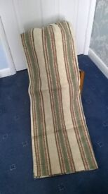 Small pair of striped curtains.