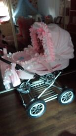 Pink baby pram and accessories