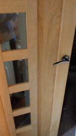 Nice wooden door with 5 window panels, hinges and handles
