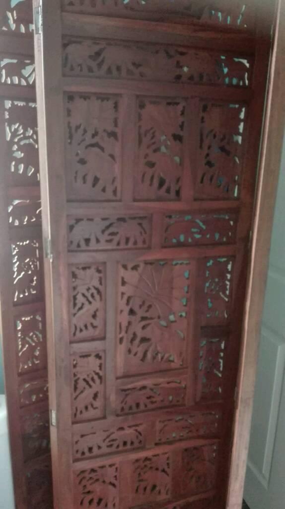 Solid carved wood room divider