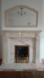 Marble fireplace with matching mirror