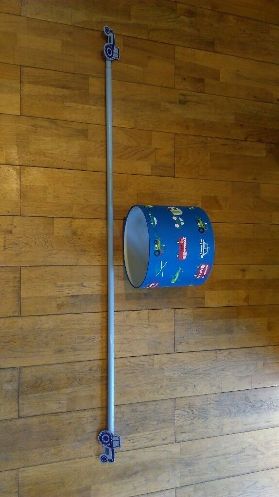 Blue curtain pole and blue lampshade