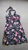 Black halter dress with pink and white floral design