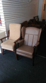 FIRESIDE CHAIRS ONE CREAM FABRIC AND ONE LEATHER GOOD CONDITION £29.99 EACH VIEWING WELCOME