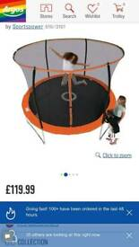 Nearly new 10ft trampoline with safety net