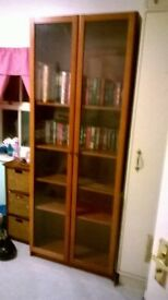 large glass fronted book shelf for sale
