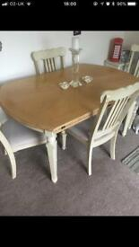 Extendable table, with 6 chairs.