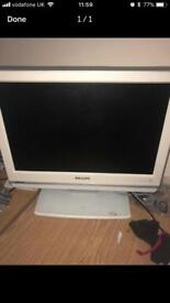 White small Philips tv with remote control