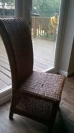 Dark wood dining room table & 4 dark wicker chairs