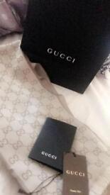 Grey Gucci scarf