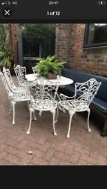 Cast garden furniture table and 6 chairs
