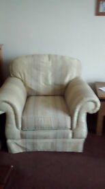 large good quality armchair, light green pattern with matching footstool with storage