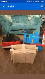 Kids sit on an go Thomas the tank engine