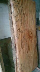 Hardwood timber seasoned / green tables worktop kitchen island shelving and firewood.