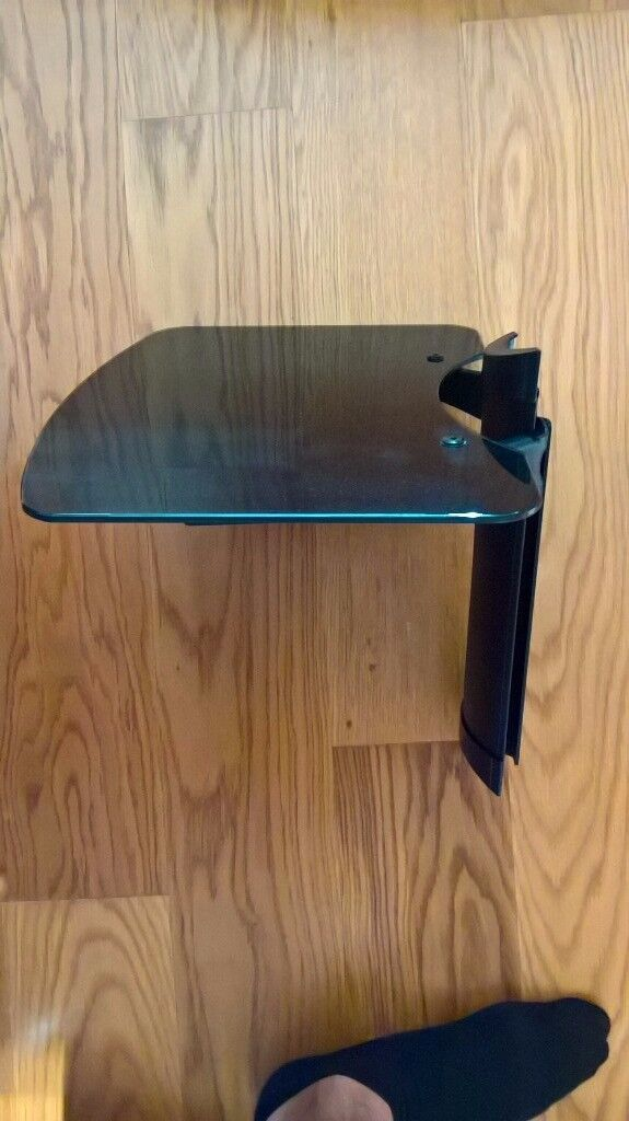 Wall mounted black glass shelf unit with cable tidy system spine at rear (£25 new, screws included)