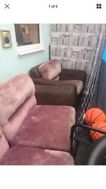 Pink and brown sofa and chair