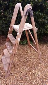 Vintage well used painters ladder great for display.