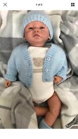 Reborn doll weighted and blue eyes