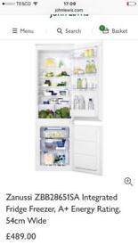 Brand new in packaging. Zanussi fridge freezer.