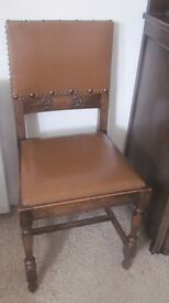 4 Oak Dining chairs with brown Rexine seats and Tudor rose carving 1940's