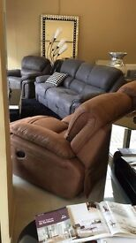Modern fabric recliner suite Available in grey cream & tan brown.