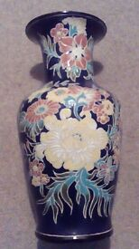 Pair of large ceramic vases with floral pattern.