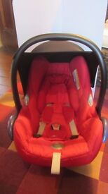 Red Maxi-Cosi Cabriofix Car Seat with pram fixtures, rain cover, mosquito net and spare black shade