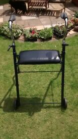 Mobility walker with seat & brakes.