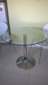 Glass topped circular kitchen table and 4 stacking chairs
