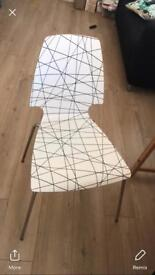4 chairs for sale, 2 white and two patterned