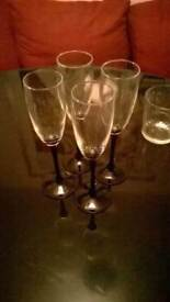 Four champagne flutes with black stems and bases perfect central London bargain