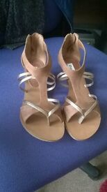 Pair of gold and tan Dune sandals