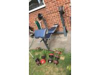 Marcy weight bench and 100kg of steel weights.