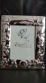 Silver plated baby photo frame 9cm x 13cm £7 Brand new in box